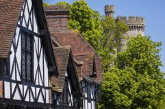 Arundel in West Sussex. The beautiful architecture in the market town of Arundel in West Sussex.  Here, the timber-framed houses are alongside a turret of Stock Photography