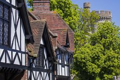 Arundel in West Sussex. The beautiful architecture in the market town of Arundel in West Sussex.  Here, the timber-framed houses are alongside a turret of Royalty Free Stock Image
