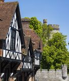 Arundel in West Sussex. The beautiful architecture in the market town of Arundel in West Sussex.  Here, the timber-framed houses are alongside a turret of Royalty Free Stock Photography