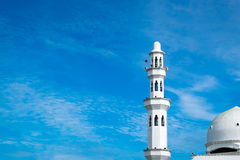 Beautiful architecture, minaret and dome of Tengku Tengah Zaharah Mosque with blue sky background Stock Photo