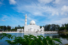 Beautiful architecture, minaret and dome of Tengku Tengah Zaharah Mosque with blue sky background. Iconic floating mosque located at Terengganu Malaysia Stock Photo