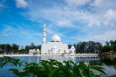 Beautiful architecture, minaret and dome of Tengku Tengah Zaharah Mosque with blue sky background Stock Photo