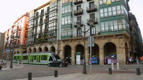 Beautiful architecture and modern public transport in street of Bilbao, Spain. Stock footage stock footage