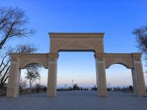Beautiful architecture near Caspian Sea, Aktau. Nice view of the Caspian Sea through a big gate with interesting architecture models in a spring evening, very royalty free stock photography