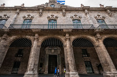 Beautiful architecture in oldest plaza in Havana with Cuban Flag. HAVANA, CUBA - March 13, 2016 : The facade of Palace of Government -Palacio de los Capitanes Stock Photos