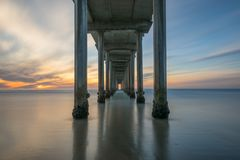 Sunset from under Scripps Pier in La Jolla California stock image