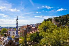 Beautiful architecture and trees of Park Guell in Barcelona royalty free stock images