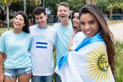 Beautiful argentinian sports fan with other supporters from Arge. Ntina outdoors on way to stadium Stock Photo