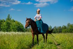 Beautiful aristocrat in a dress on a horse.  royalty free stock images