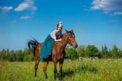 Beautiful aristocrat in a dress on a horse.  royalty free stock photos