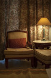 Beautiful armchair and lamp in a hotel room Royalty Free Stock Photo