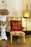 Beautiful armchair old style lamp and flowers. Royalty Free Stock Photo