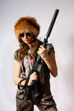 Beautiful armed girl in hat Stock Images