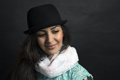 Beautiful armenian girl in a hat posing in a. Girl posing in a studio on black background Royalty Free Stock Image