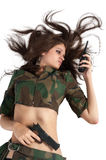 Beautiful army girl holding pistol and radio Royalty Free Stock Images