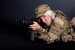 Beautiful army girl with rifle. Isolated on black Stock Photo