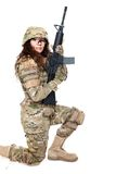 Beautiful army girl with rifle. Isolated on white Stock Photo