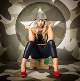 Beautiful army pinup woman on ammo box Royalty Free Stock Image