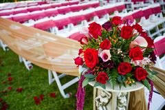 Beautiful arrangement of flowers in a wedding aisle. Royalty Free Stock Photo