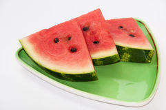 A beautiful arrangement of pieces of watermelon on a green plate Royalty Free Stock Image