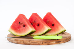 A beautiful arrangement of pieces of watermelon on a wooden boar Stock Photos