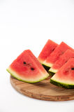 A beautiful arrangement of pieces of watermelon on a wooden boar Stock Photography