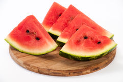 A beautiful arrangement of pieces of watermelon on a wooden boar Royalty Free Stock Photography