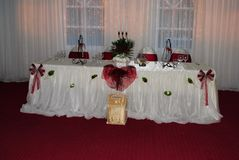 Wedding arrangement with white and red chairs waiting g guests royalty free stock photo