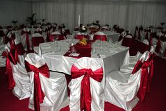 Wedding arrangement with white and red chairs waiting g guests royalty free stock image