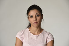Beautiful arrogant and moody latin woman showing negative feeling and contempt facial expression Stock Photo