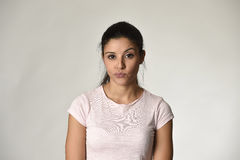Beautiful arrogant and moody spanish woman showing negative feeling and contempt facial expression Stock Image