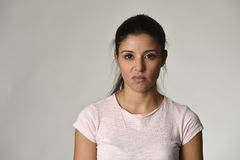 Beautiful arrogant and moody spanish woman showing negative feeling and contempt facial expression stock photography