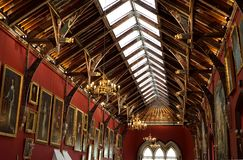 Beautiful art and architecture in rafters. The painted ceiling rafters in the portrait gallery of this medieval castle in Kilkenny, Ireland offer rich colors stock photo