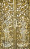 Beautiful art crafted door of a temple. This yellow gold crafted door is at Wat Sri Punn Ton, in the North of Thailand Stock Photography
