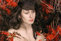 Beautiful art portrait of Nude woman lying in the branches with Royalty Free Stock Photo