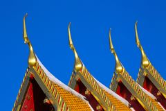 Beautiful art of the temple roof. Stock Photos