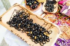 Beautiful artesanal coconut rings sold at handicraft fairs in bahia in brazil. Black colors stock photo