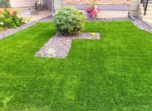 A beautiful artificial lawn in the suburbs of Edmonton. A new trend in lawn care stock photo