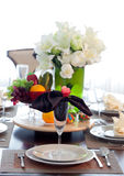 The beautiful artificial white flowers, dish set and fruits Stock Photography