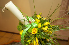 Yellow flower arrangement for baptism candle Stock Photos