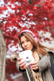 Beautiful Asea young woman holding a camera. Stock Photography