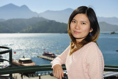 Beautiful asia girl with lake and mountain background Stock Photo