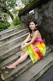 Beautiful asia girl sitting on stair Royalty Free Stock Photography