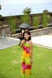 Beautiful asia girl stay on lawn Royalty Free Stock Image