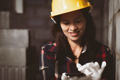 Asia woman working at the site works with happy. royalty free stock image