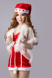 Beautiful asia woman model in Santa Claus clothes. In studio Stock Photo