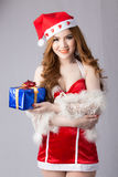 Beautiful asia woman model in Santa Claus clothes. In studio Stock Photography