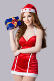 Beautiful asia woman model in Santa Claus clothes. In studio Royalty Free Stock Photos