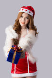 Beautiful asia woman model in Santa Claus clothes. In studio Royalty Free Stock Images
