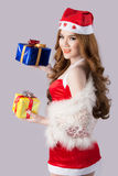 Beautiful asia woman model in Santa Claus clothes. In studio Royalty Free Stock Photo